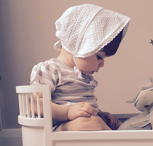 Preciously Me blog : My baby girl at 9 months playing in her doll cot