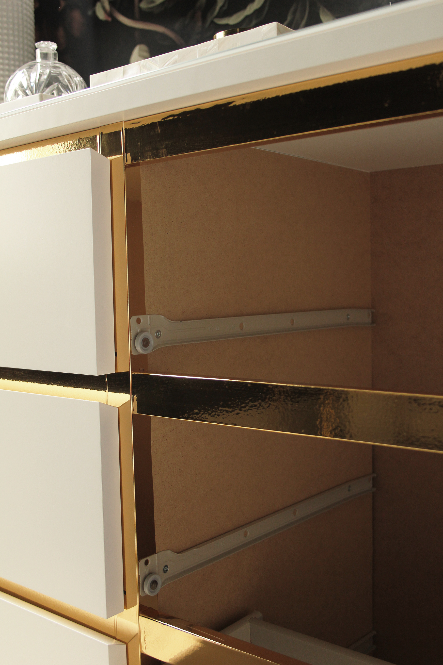 Preciously Me blog : DIY - Ikea Hack, Customize and Glamorize a Malm dresser with gold contact paper. Looks like a beautiful vintage style credenza